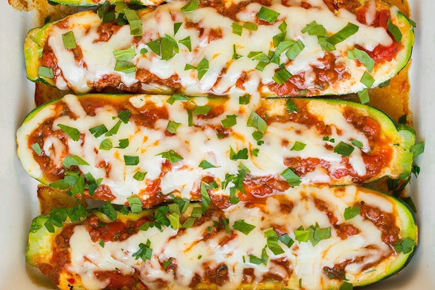 zucchini halves filled with meat sauce and cheese