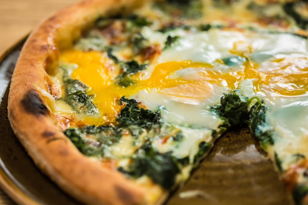 pizza with yolky egg on top