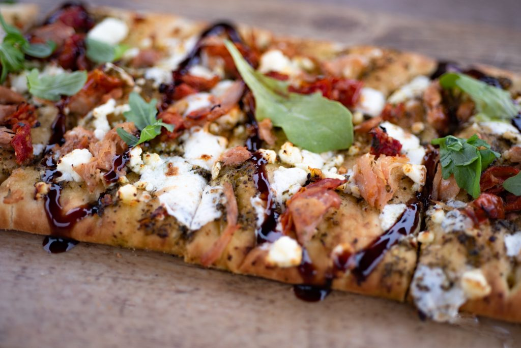 Flatbread pizza drizzled with balsamic glaze