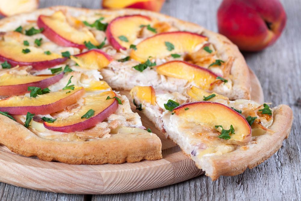 Peaches sliced on a pizza